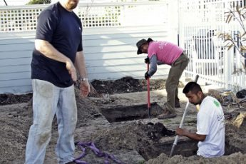 men digging holes in the ground